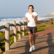 Healthy teen girl jogging by the beach — Stockfoto