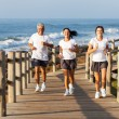 Fit family jogging at the beach — Stock Photo #25264419