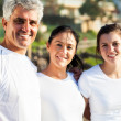Stock Photo: Happy family in sportswear at the beach
