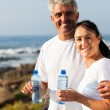 Fit mature couple drinking water — Stock Photo