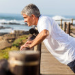 Fit senior man exercising at the beach — Stock Photo #25267529