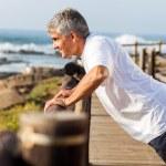 Fit senior man exercising at the beach — Stock Photo #25267529