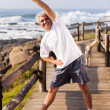 Happy senior man doing morning exercise — Stock Photo