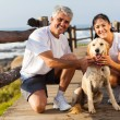 Sporty middle aged couple and pet dog — Stock Photo