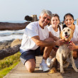 Sporty family and pet dog at the beach — Stock Photo #25268231