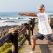 Active middle aged man doing morning workout - Stok fotoğraf