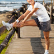 Active middle aged woman doing morning exercise - Foto Stock