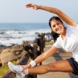 Fit mature woman doing morning stretching - Foto Stock