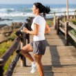 Healthy mature woman doing exercise at beach — Stock Photo