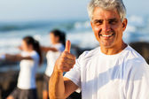 Mature man giving thumb up — Stock Photo