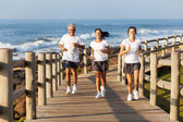 Fit family jogging at the beach — Stock Photo