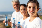 Fit family with water bottle after exercise — Stock Photo