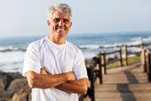 Active mid age man on the beach — Stock Photo