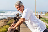 Healthy middle aged man workout at the beach — Stock Photo