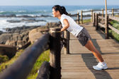 Fit middle aged woman exercising at beach — Stock Photo