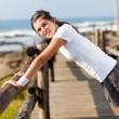 Healthy teenager girl doing morning workout - Stock Photo