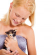 Teen girl holding kitten — Stock Photo