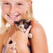 Happy little girl holding kitten — Stock Photo
