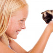 Caring teen girl holding kitten — Stock Photo