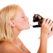 Loving little girl kissing kitten — Stock Photo