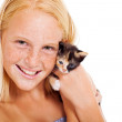 Cute teen girl holding pet kitten — Stock Photo