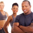 Handsome male personal trainer and team — Stock Photo #25277733