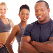 Handsome male personal trainer and team — Stock Photo