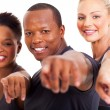 Group of gym instructors pointing at the camera — Stock Photo