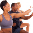 Stock Photo: Group of fit exercising