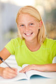 Casual preteen girl studying — Stock Photo