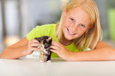 Lovely pre teen girl with pet kitten — Stock Photo