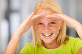 Happy pre teen girl looking — Stock Photo