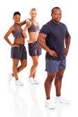 Instruktor afrykańskiego człowieka z dwóch członków siłowni na tle — Zdjęcie stockowe