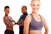 Fit woman and two gym members — Stock Photo