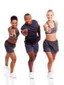 Cheerful group fit inviting to join exercise — Stock Photo