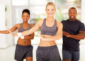 Sporty group exercising — Stock Photo