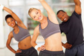 Personal trainer exercise with two africans — Stock Photo