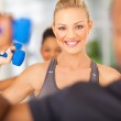 Woman exercise in gym with dumbbells — Stock Photo #25280449