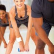 In a row doing fitness exercise with dumbbell — Stock Photo