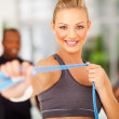 Woman exercise in gym with jumping rope — Stock Photo #25280821