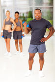 African man holding dumbbell — Stock Photo