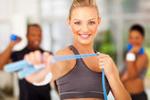 Woman exercise in gym with jumping rope — Stock Photo