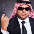 Arab hit man holding gun — Foto de Stock