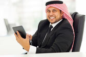 Arabian businessman browsing internet on tablet computer — Stock Photo