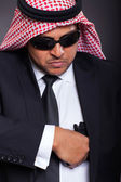 Middle eastern hitman drawing his handgun — Stock Photo
