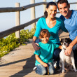 Stock Photo: Young family with pet dog