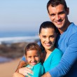 Loving family at the beach — Stock Photo #25514647