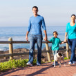 Young family walking their dog — Stockfoto