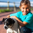 Stock Photo: Little girl with her pet dog