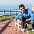 Young man with his pet dog — Stock Photo